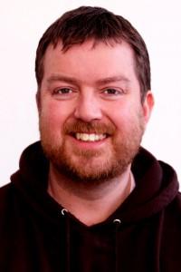 Mark Arnold - brown hoodie photo